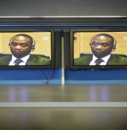 Congolese warlord Germain Katanga is seen on the television screens in the pressroom of the International Criminal Court (ICC) during his trial in The Hague, Netherlands