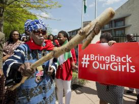 Protesters demand the Nigerian government take action to rescue the kidnapped girls. © Manuel Balce Ceneta/AP