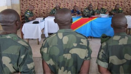 Congolese soldiers stand in court. © BBC News