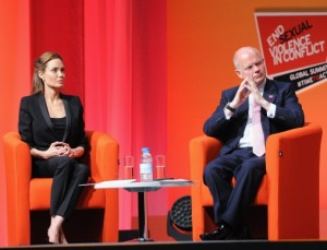 Angelina Jolie and UK Foreign Minister William Hague at the Global Summit to End Sexual Violence in Conflict. © Eamonn M. McCormack/Getty Images