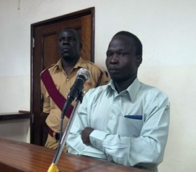Former LRA commander Thomas Kwoyelo sits in a northern Uganda courtroom. © AFP/Getty
