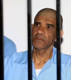 Former Libyan spy chief Abdullah Al-Senussi sits in a Libyan courtroom. © AFP Photo/Mahmud Turkia