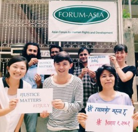 Staff from FORUM-ASIA show their support for international justice. © FORUM-ASIA