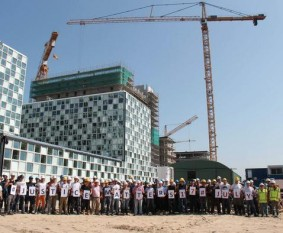 Workers at the site of the ICC permanent premises show their support for International Justice Day. © ASP President Tiina Intelmann