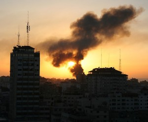 As the sun sets, smoke rises from the Gaza skyline. © Al Jazeera English/Flickr