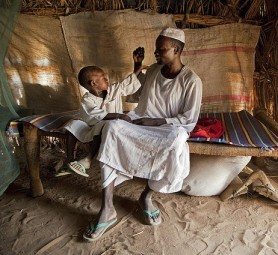 A father and son in North Darfur IDP camp. © UN Photo/Flickr