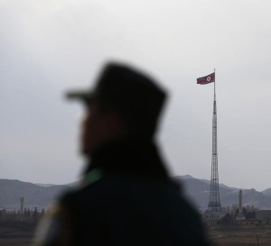 A North Korean flag flutters on top of a tower at the propaganda village of Gijungdong in North Korea.  © 2014 Reuters
