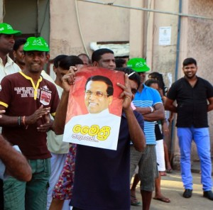 Supporters of Maithripala Sirisena celebrate his election victory. © AP/Eranga Jayawardena