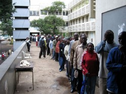 Kenyans wait to vote. Some argue that ICC involvement contributed to a significant decline in violence in the most recent election because Kenyan political leaders knew they were under the watchful eye of the court. © Flickr/ianschuler (Some rights reserved)