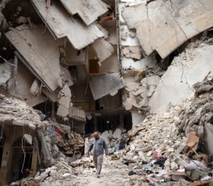 A man walks amid a destroyed building in Aleppo, Syria. © DIMITAR DILKOFF/AFP/Getty Images