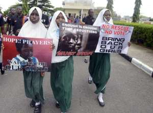 Women protest in support of the girls abducted from Chibok. © AFP Photo/Pius Utomi Ekpeipius Utomi Ekpei