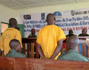 Two defendants stand in a DRC courtroom. © Physicians for Human Rights
