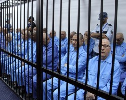 Former Libyan government officials sit on trial in Tripoli. © Xinhua/REX Shutterstock