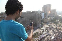An activist uses his phone to record video of protests in Cairo. © Ryan Kautz/WITNESS