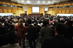 1024px-Plenary_Hall_12th_AU_Summit_090202-N-0506A-291
