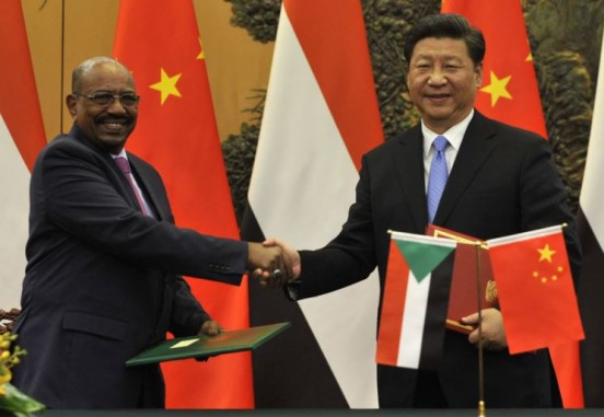 ICC fugitive Omar al-Bashir with Chinese President Xi Jinping. Beijing, 1 Sept 2015. © AFP