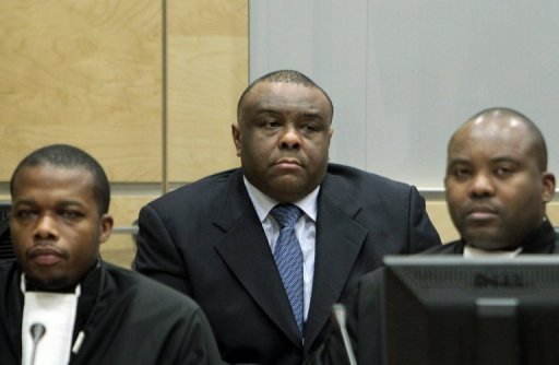 Jean-Pierre Bemba (center) with his former defense team, and now with co-accused, Aimé Kilolo-Musamba (right) and Jean-Jaques Mangenda Kabongo (left). © ICC