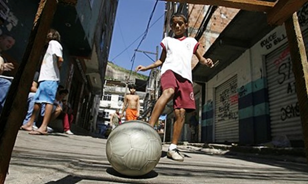 11-year-old Victor Soares plays football at Rio de Janeiro's Rocinha favela Photograph: Vanderlei Almeida/AFP/Getty Images