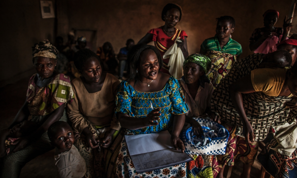 Kahindo Siherya Alphonsine (centre), an activist from SOFEPADI, meets with women inside a makeshift sewing studio in the village of Mangango, in North Kivu, in March 2014. In many cases, survivors of rape are stigmatised and rejected by their families ― leaving them unable to care for their children. SOFEPADI initiated sewing workshops as part of its support for survivors of sexual violence, providing women with a positive space to learn a new trade while creating a new community. Photograph: Pete Muller