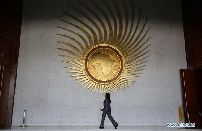 A woman walks outside a conference hall at the African Union (AU) Headquarters in Addis Ababa, capital of Ethiopia, on Jan. 28, 2016. Xinhua