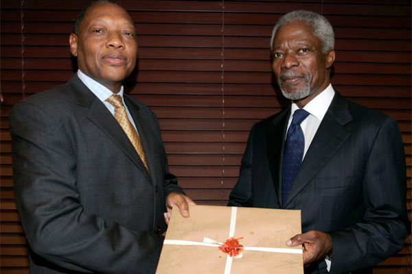 Former UN Secretary-General Kofi Annan (right) receives a sealed envelope with a report on Kenya's post-election violence in 2007 from Justice Philip Nyamu Waki, head of the Commission of Inquiry into the Post-Election Violence, at Serena Hotel in Nairobi October 17, 2008. | NATION MEDIA GROUP.