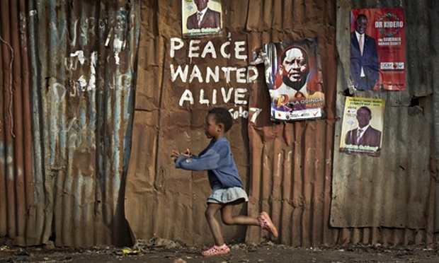 Pro-peace graffiti has been daubed on a wall in Kibera slum, Nairobi, during clashes in 2007. Photograph: Ben Curtis/AP