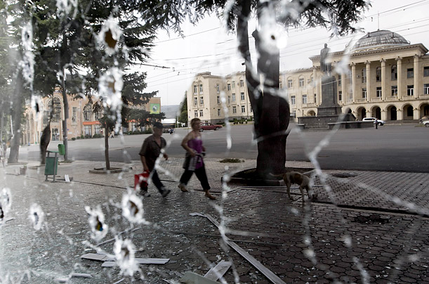 The main square of Gori is reflected in a bullet-ridden window.PHOTOGRAPHS FOR TIME BY YURI KOZYREV NOOR