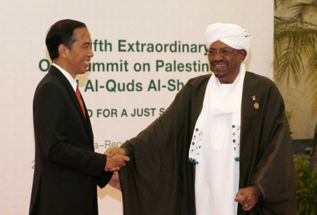 "Indonesian President Joko ""Jokowi"" Widodo, left, greets his Sudanese counterpart Omar al-Bashir upon his arrival for the extraordinary Organization of Islamic Cooperation (OIC) summit on Palestinian issues in Jakarta, Indonesia, Monday, March 7, 2016. Al-Bashir is wanted by the International Criminal Court on war crimes allegations linked to the conflict in Sudan's Darfur region. Darren Whiteside/Pool Photo via AP"