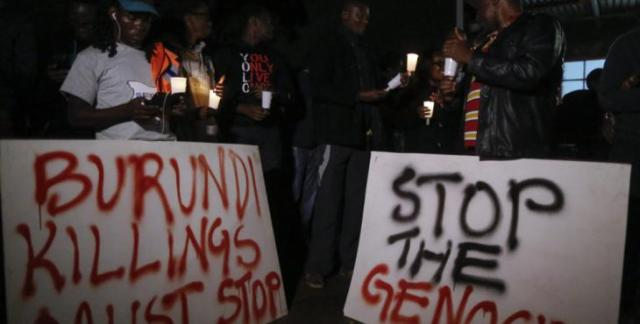 Dai Kurokawa_Kenyan activists and Burundian expatriates hold placards and candles during a candlelight vigil held for Burundi in Nairobi