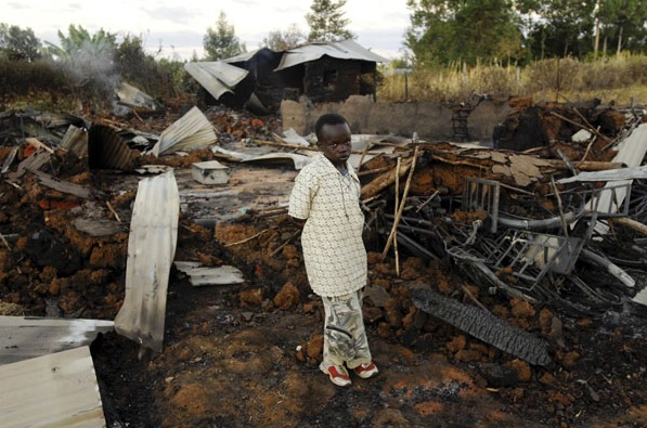 RS_Georgina Cranston_ An 11 year old survivor at the remains of a church burnt on 1st January 2008 where at least 18 people died during post election violence in Kenya