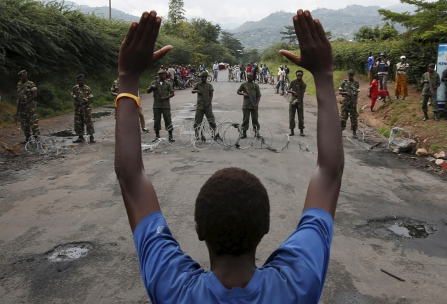 A protester holds his hands up in front of soldiers during a protest against Burundi President Pierre Nkurunziza and his bid for a third term in Bujumbura, May 19. Goran Tomasevic/Reuters